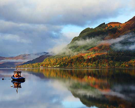 A Scottish loch with a boat on it